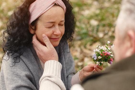 happy-senior-woman-with-delicate-flowers-Gustavo Fring